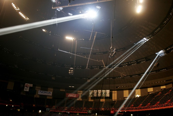 Huge shafts of light filter through the damaged roof of the Louisiana Superdome in New Orleans.